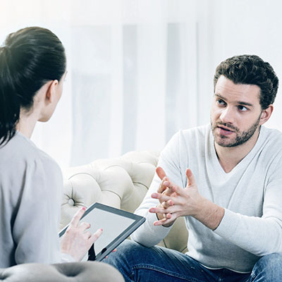 financial provision lawyer with client discussing finances