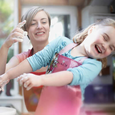 mother and child baking and happy