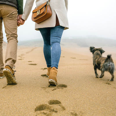 content couple walking beach
